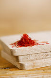 Moroccan saffron treads in pile, on wood Royalty Free Stock Images