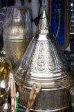 Moroccan souvenir and utensil market. Metal utensil stamping on Royalty Free Stock Image