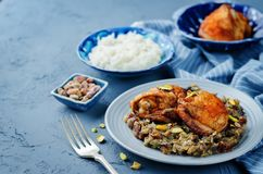 Moroccan spiced chicken with dates and aubergines. Toning. selective focus Royalty Free Stock Photography