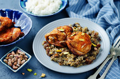 Moroccan spiced chicken with dates and aubergines. Toning. selective focus Stock Photo