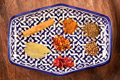 Moroccan spices. Mixed spices on a patterned blue plate Stock Photo