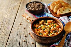 Moroccan spicy green lentils chickpea soup. On a wood background. toning. selective focus royalty free stock images