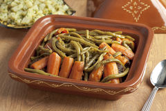 Moroccan square tagine with meat, green beans and carrots Stock Photos