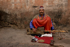 Moroccan street musician was playing Gimbri. Stock Photos