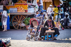 Moroccan Street Vendor. Local Moroccan lady trying to make a living by selling baked goods in the main square of Marrakesh Stock Photo