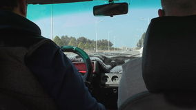 Moroccan street view from old car. View from inside of an old tatty car while driving on wide street of Agadir city in Morocco stock video footage