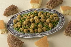 Moroccan style minced chicken balls, green peas bread royalty free stock photos
