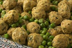 Moroccan style minced chicken balls and green peas stock images