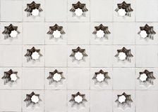 Moroccan style star perforated wall background Royalty Free Stock Image