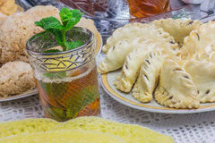 Moroccan sweets with mint tea Stock Photo
