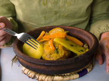 Moroccan Tagine And Human Hand Royalty Free Stock Photography