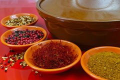 Moroccan tahine with four bowls with spices on red background Royalty Free Stock Photos