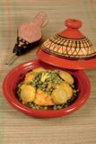 Tajine chicken and peas royalty free stock images
