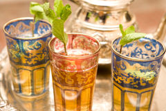 Moroccan Tea cups on silver plate. 3 traditional Moroccan teacups with mint sprig royalty free stock photos