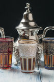Moroccan tea glasses of colors. And metal teapot Stock Photography