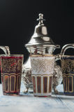 Moroccan tea glasses of colors. And metal teapot Royalty Free Stock Image