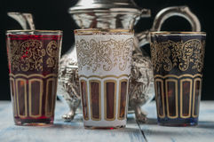 Moroccan tea glasses of colors. And metal teapot Stock Photos