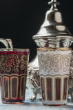 Moroccan tea glasses of colors. And metal teapot Stock Photo