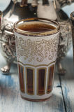 Moroccan tea glasses of colors. And metal teapot Royalty Free Stock Photo