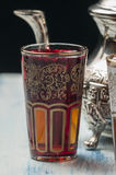 Moroccan tea glasses of colors. And metal teapot Stock Image