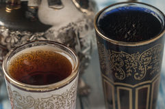 Moroccan tea glasses of colors. And metal teapot Stock Images