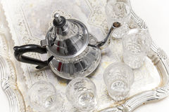 Moroccan tea. Metal Arabic teapot with glasses Royalty Free Stock Photo