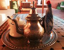 Moroccan tea. Metal Moroccan teapot in Stock Photography
