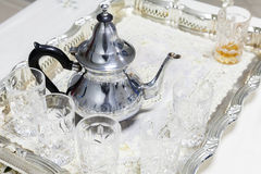 Moroccan tea. Metal teapot with glasses. Moroccan tea theme. Metal teapot with glasses Royalty Free Stock Images