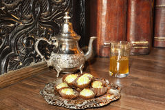 Moroccan tea with pastries. Moroccan tea with pastries in a silver dish Royalty Free Stock Photography