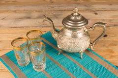 Moroccan tea pot. And traditional tea glasses Royalty Free Stock Photography