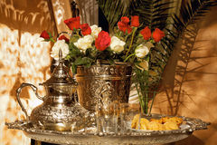 Moroccan tea set with pasteries. And white and red roses. Traditional arabic and moroccan tea culture Stock Photo