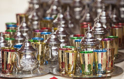 Moroccan tea sets. Glasses of colors, metal teapots and silver-plated trays Stock Photos