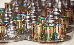 Moroccan tea sets. Glasses of colors, metal teapots and silver-plated trays Royalty Free Stock Photo