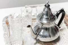 Moroccan tea theme. Shining metal teapot. With glasses Royalty Free Stock Photo