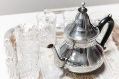 Moroccan tea theme. Shining metal teapot Royalty Free Stock Photo
