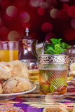 Moroccan tea with traditional cookies Stock Photography