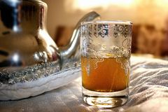 Moroccan Traditional Tea set up. Silver plated Teapot and moroccan berber decorated cup of tea Stock Photography