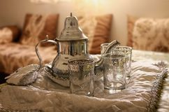 Moroccan Traditional Tea set up. Silver plated Teapot and moroccan berber decorated cup of tea Stock Image