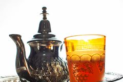 Moroccan traditional Tea table. Close up of a moroccan tea pot and glass Royalty Free Stock Image