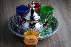 Moroccan traditional Tea table. Close up of a moroccan tea pot and glasses on a wooden table Royalty Free Stock Photo