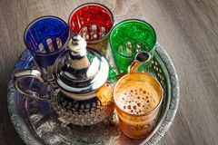 Moroccan traditional Tea table. Close up of a moroccan tea pot and glasses on a wooden table Royalty Free Stock Photos