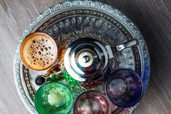 Moroccan traditional Tea table. Close up of a moroccan tea pot and glasses on a wooden table Stock Photography