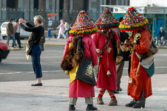 Moroccan water sellers. Unidentified water sellers on the street of Casablanca, Morocco. Water sellers are dressed in colorful dress, ringing brass bells and stock photography