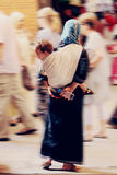 Moroccan woman carrying her baby in Fez, Morocco Stock Images