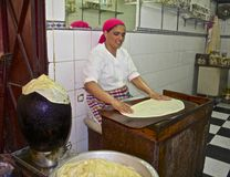 Moroccan woman cooking Stock Photography