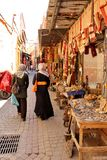 Moroccan women in the colorful streets of the main souk of Marrakesh Royalty Free Stock Photos