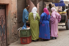 Moroccan women at a foodstall Stock Images