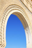 Morocco arch in africa old construction. In the blue sky Royalty Free Stock Image