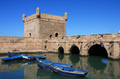 Morocco Essaouira. UNESCO World Heritage Site - the Port Scala or bastion with typical blue fishing boats Royalty Free Stock Photo