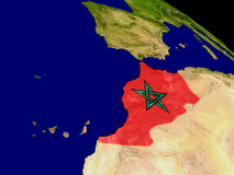 Morocco with flag on Earth Stock Images